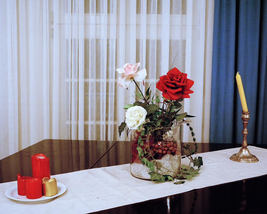 Still life in the common room of 'Reinoldus zur Pflichttreue' Lodge, Dortmund, Germany, 2013. The three roses symbolize light, love and life.