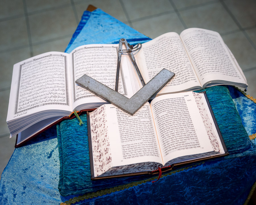 Three holy books (Koran,New Testament and Old Testament) opened on the altar at the Lodge building in Haifa, Israel, 2016.